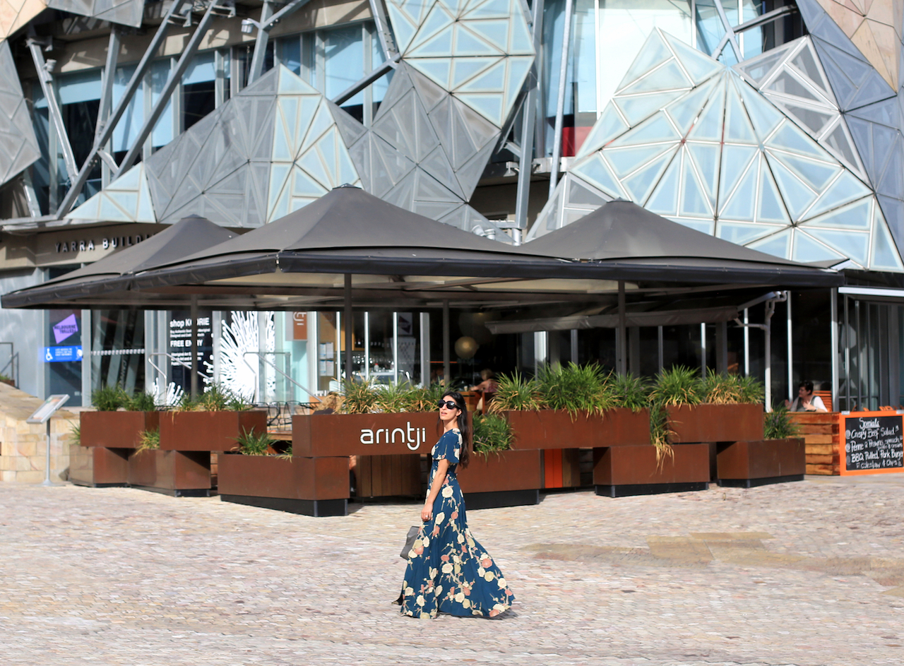 Bigger, bolder prints give you more freedom to play with accessories like big bags with gold hardware or chunky lace-up shoes | Federation Square - Melbourne, Australia