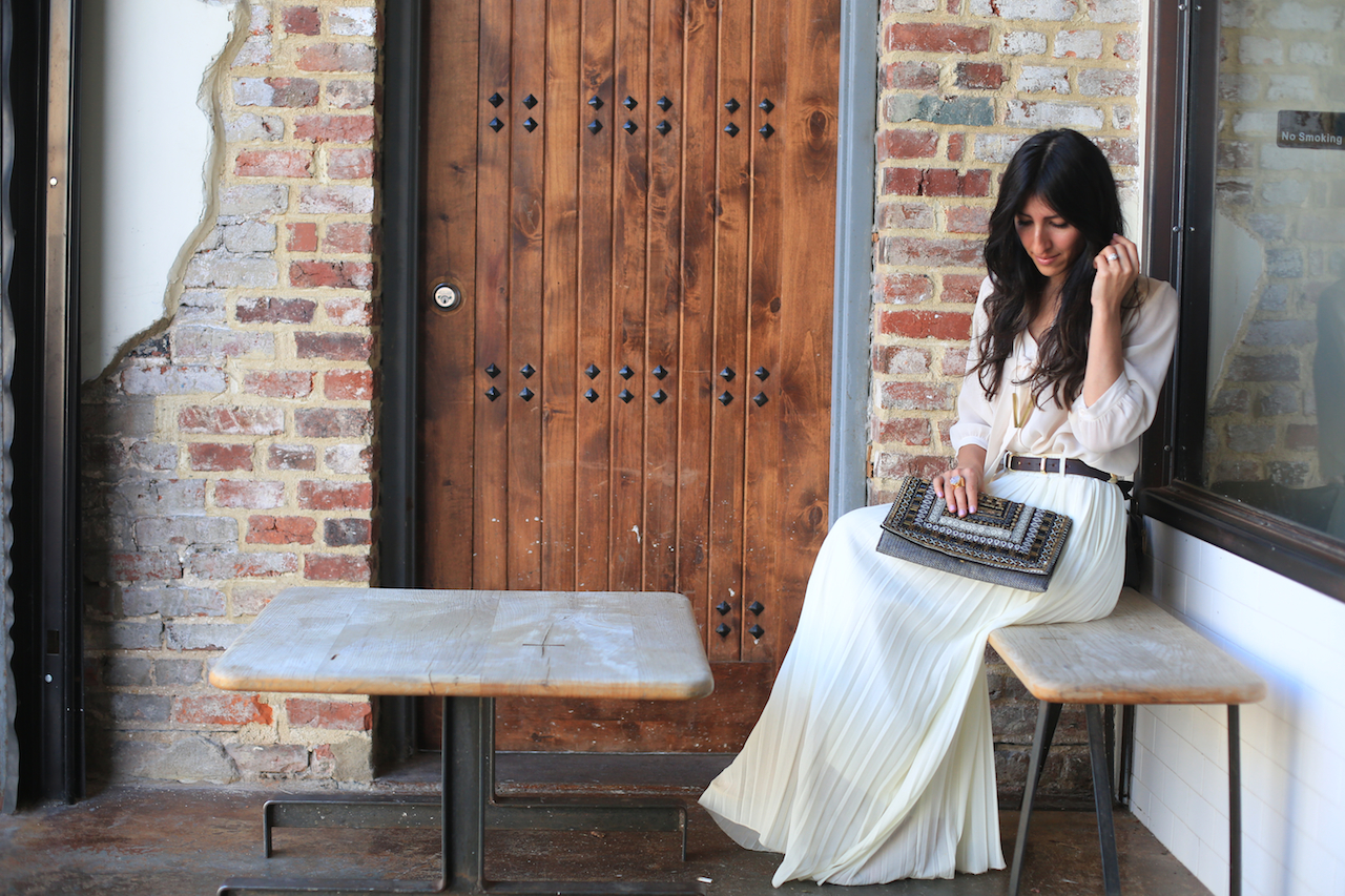white skirt outfit sitting down outside la colombe