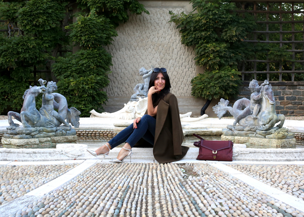 dumbarton-oaks-pebble-garden-fountain-theory-jacket-sitting-smiling