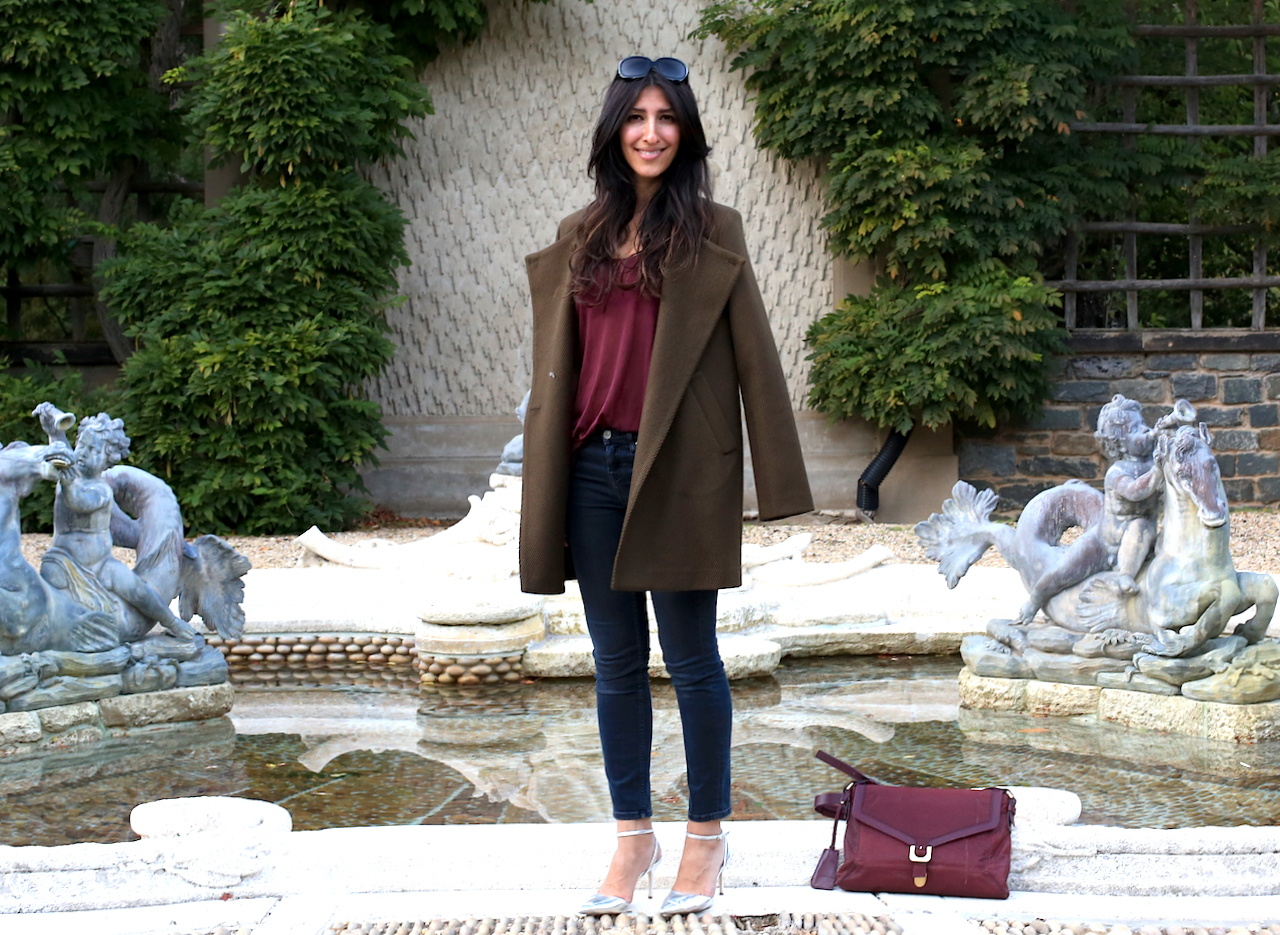 dumbarton-oaks-pebble-garden-fountain-theory-jacket-standing-smiling