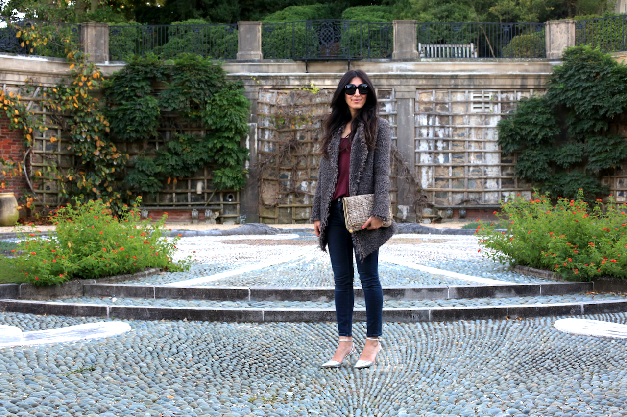 dumbarton-oaks-pebble-garden-iro-jacket-standing-not-smiling