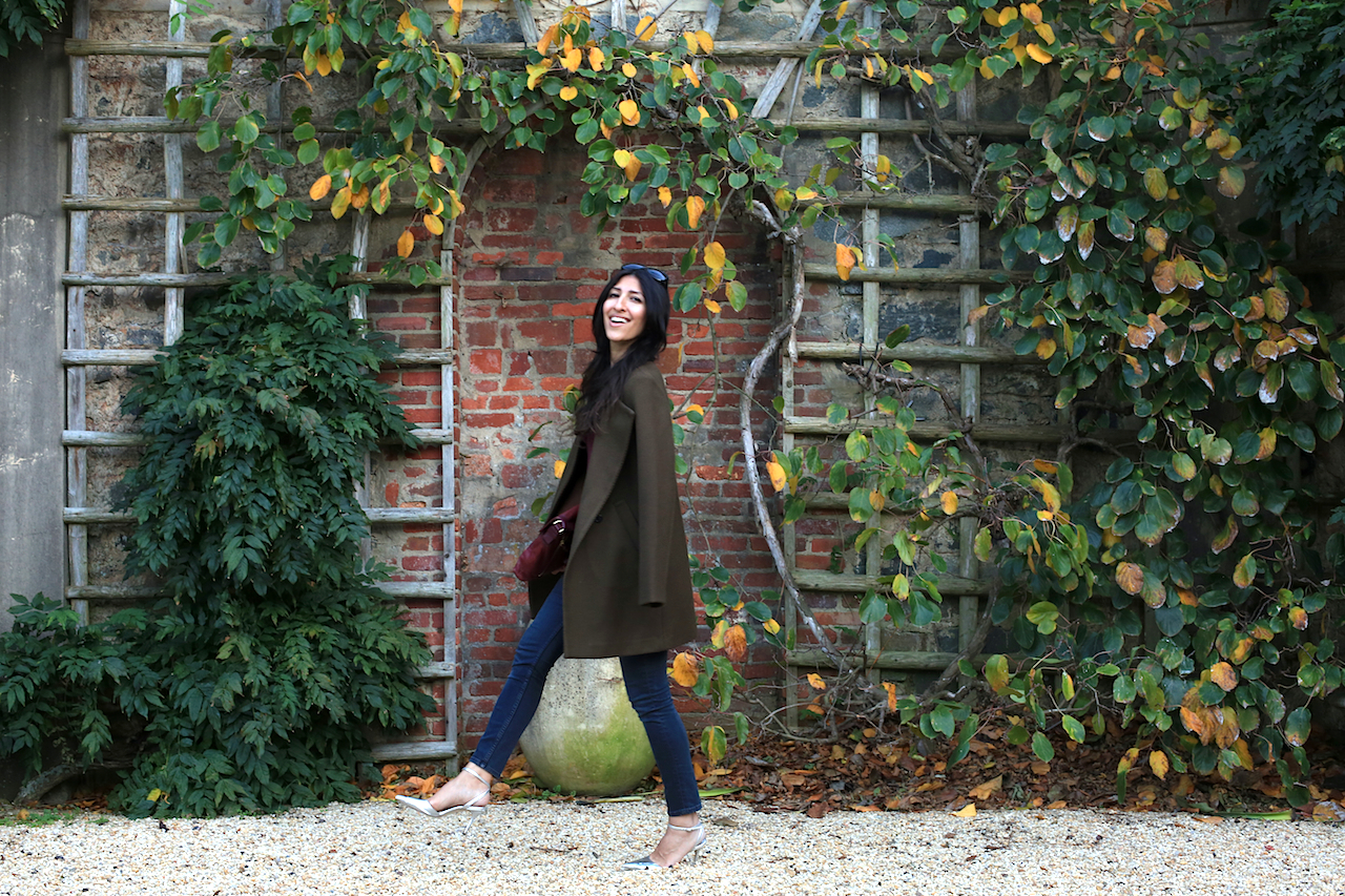dumbarton-oaks-pebble-garden-ivy-wall-theory-jacket-laughing-walking
